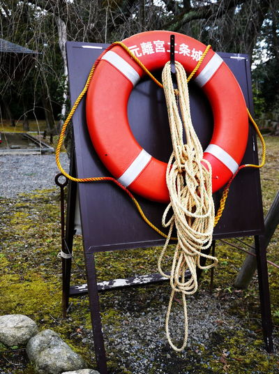 Close-up Japanese  Lifesaver No People Precaution Red Rope Safety Sandwich Board