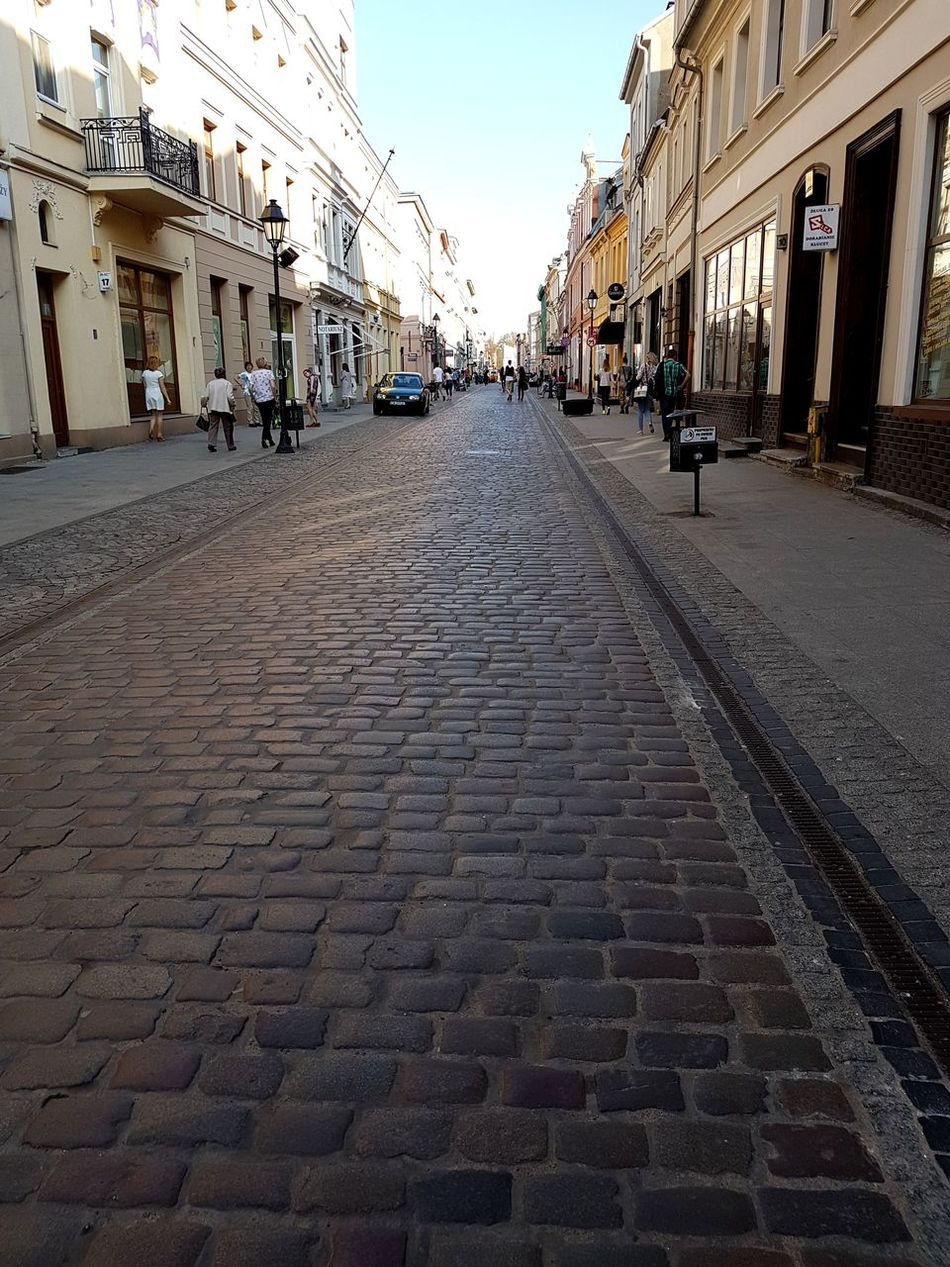 Architecture Building Exterior Street City Travel Destinations The Way Forward Cobblestone Outdoors Day Bydgoszcz Poland Vacations Architecture City Travel Built Structure Polandarchitecture Sky No People City Gate