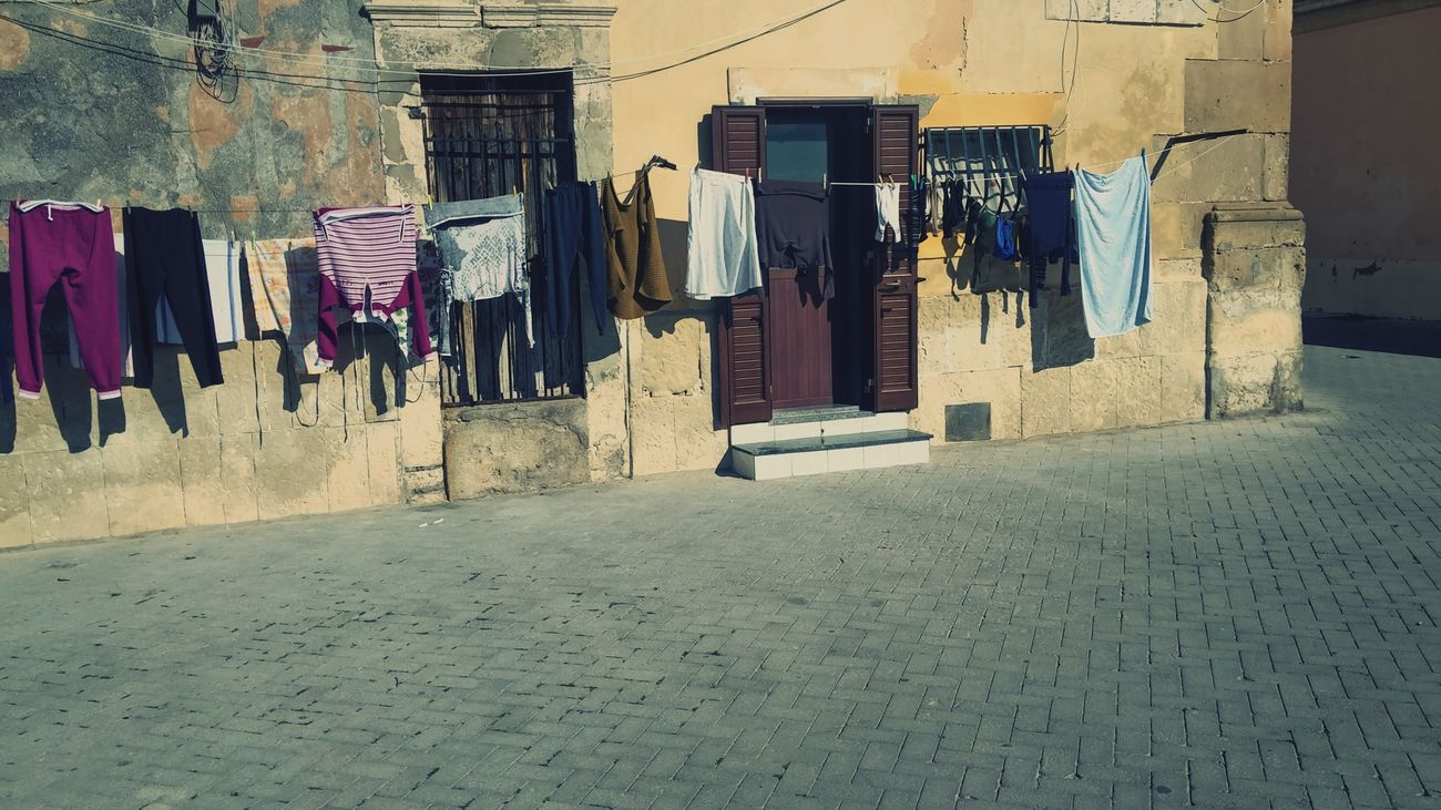 The City Light Clothesline Drying Laundry Sunlight Outdoors No People Sunny Day In The City Holiday Trip Sicilianjourney Walking Februar 2017 Syracusa I Love Sicilia Sunny Day 🌞 Domestic Life Day Ortigiaisland