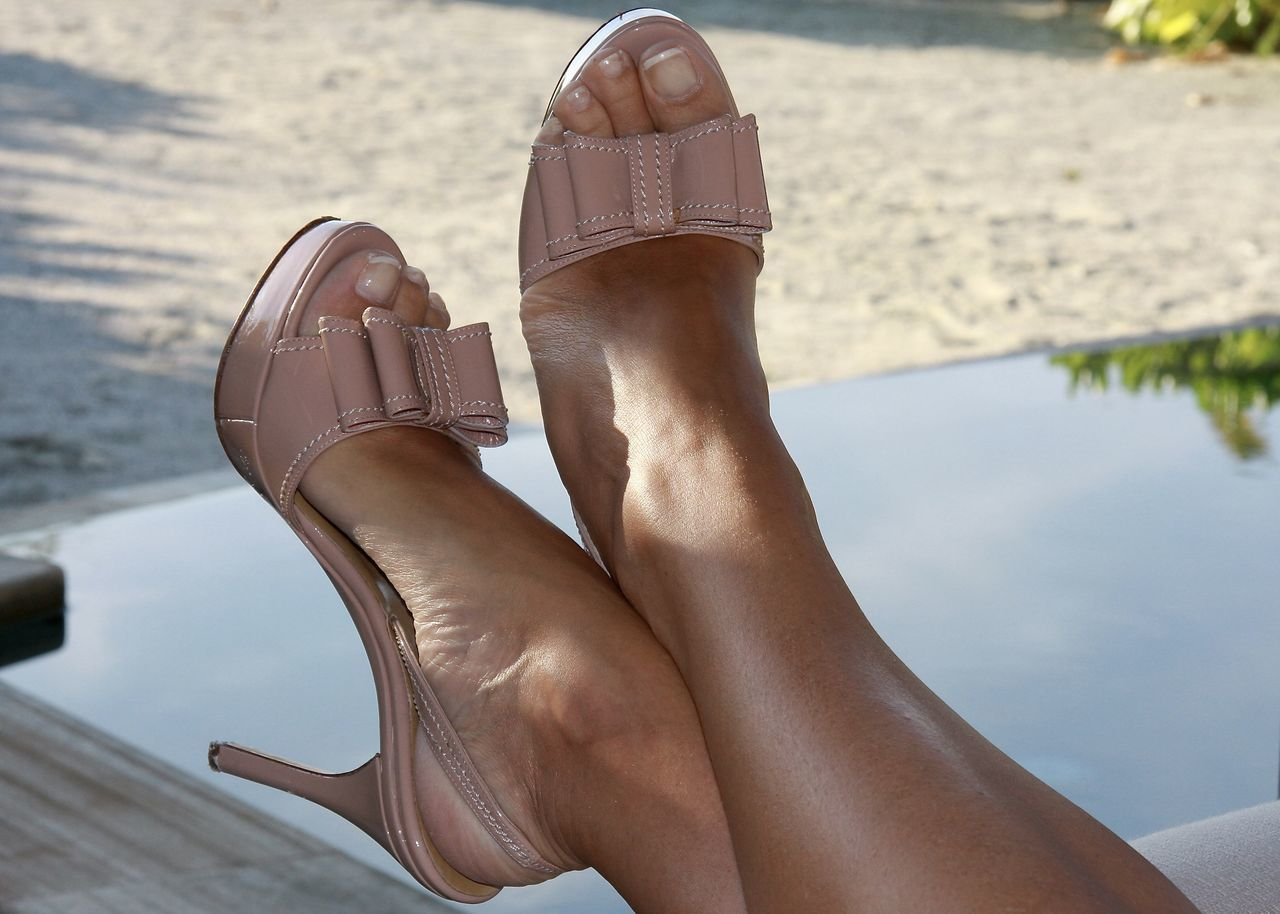 human leg, low section, human foot, real people, barefoot, human body part, one person, day, outdoors, shoe, lifestyles, water, leisure activity, women, sand, relaxation, close-up, people