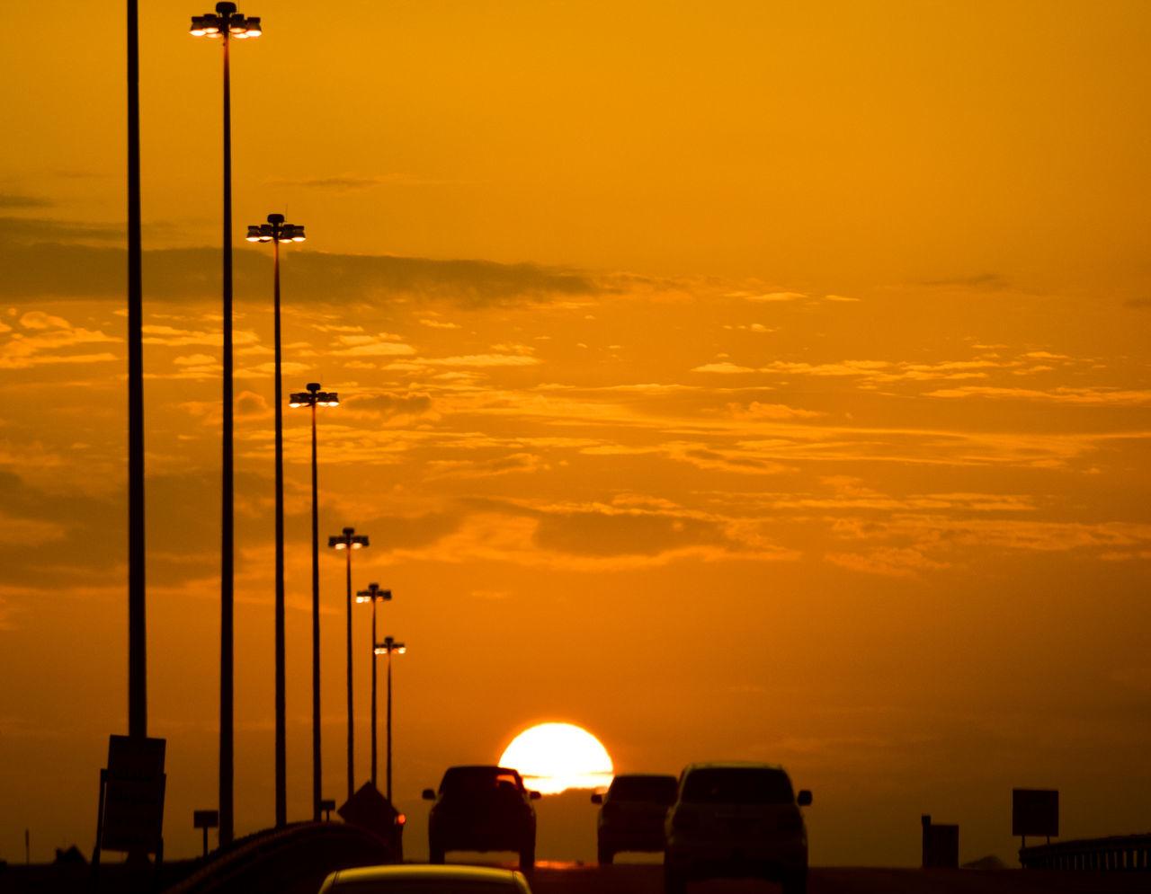 sunset, orange color, sky, cloud - sky, silhouette, nature, sun, beauty in nature, outdoors, transportation, no people, scenics, architecture