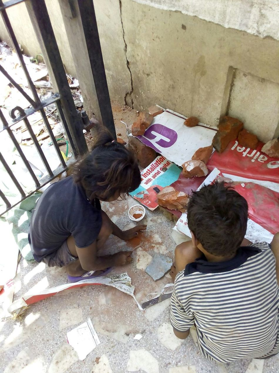 Street children building a house for play at Kulharia complex campus.