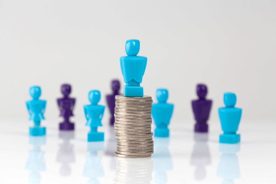 Male figurine placed on top of pile of coins with additional figurines in the background. Leadership and corporate structure concept Business Copy Space Arrangement Chess Chess Piece Close-up Coin Concept Conceptual Conceptual Photography  Copy Space Day Female Figurine  Figurines  Finance Gender Equality Indoors  Knight - Chess Piece Large Group Of Objects Male Money Money Distribution No People Still Life Studio Shot Wage Gap White Background