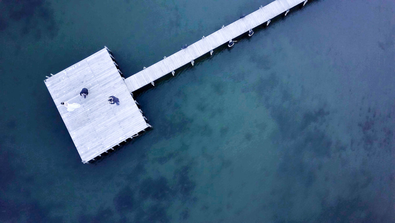 bride and groom photo session Aerial View Architecture Beauty In Nature Bride Building Exterior Built Structure Camera - Photographic Equipment Day Drone  Groom High Angle View Lake Outdoors Photosession Pier Taking Video Tranquility Video Water Wedding Photography