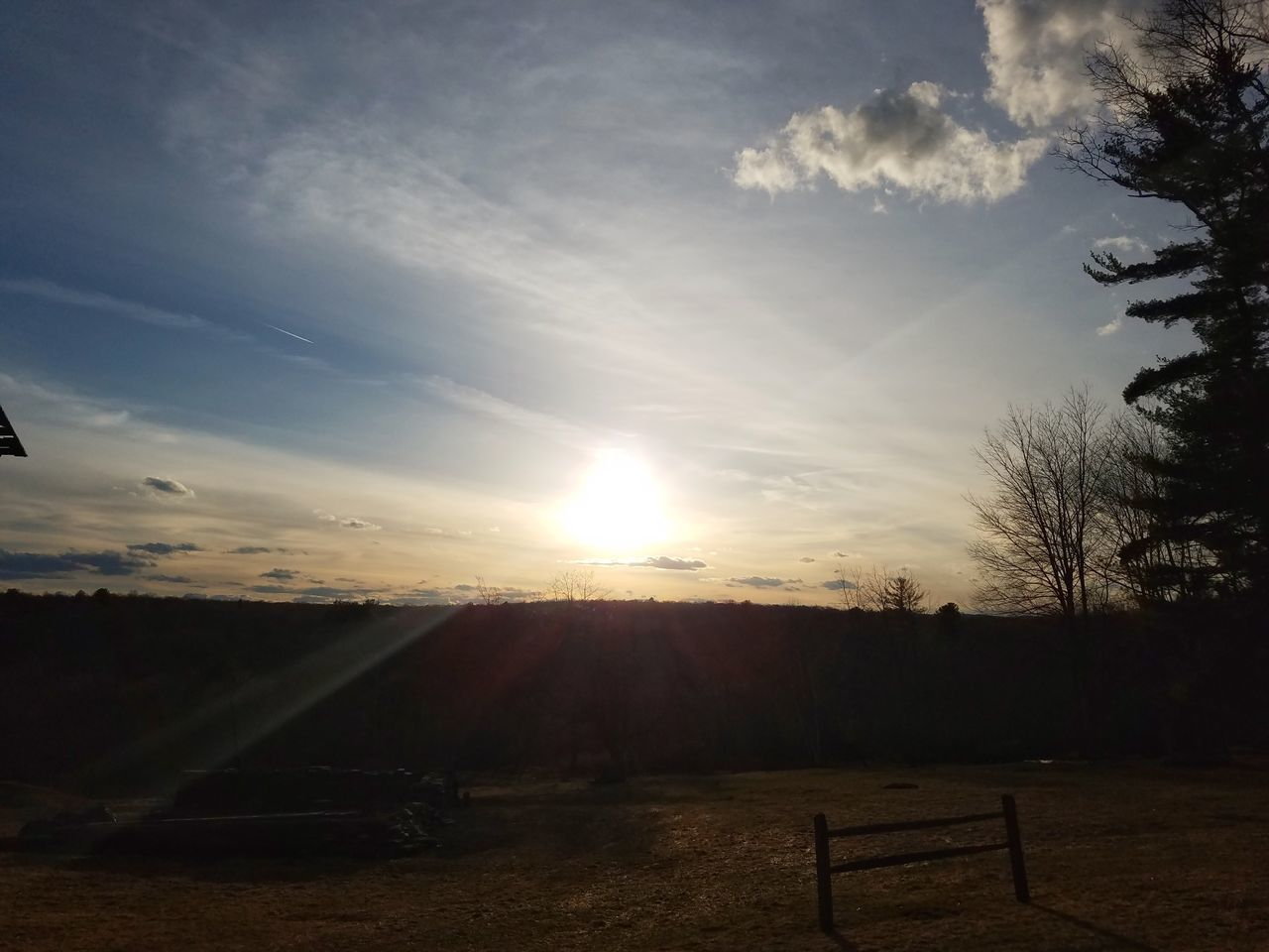 sunbeam, landscape, tranquility, tranquil scene, beauty in nature, sky, sunset, no people, field, nature, scenics, sunlight, sun, outdoors, tree, day