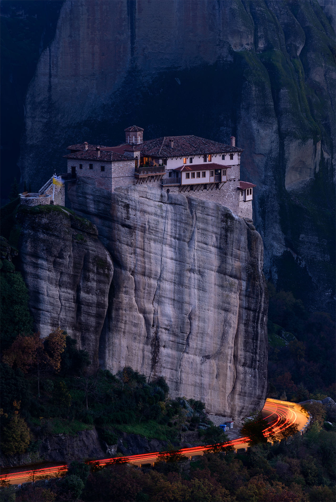 The Roussanou monastery in Meteora, Greece at night Belief Church Cliff Dusk Greece Hellas Hill Landmark Light Light And Shadow Lights Meteora Monastery Mountain Night Pray Religion Trail Trails Travel Travel Destinations VisitGreece