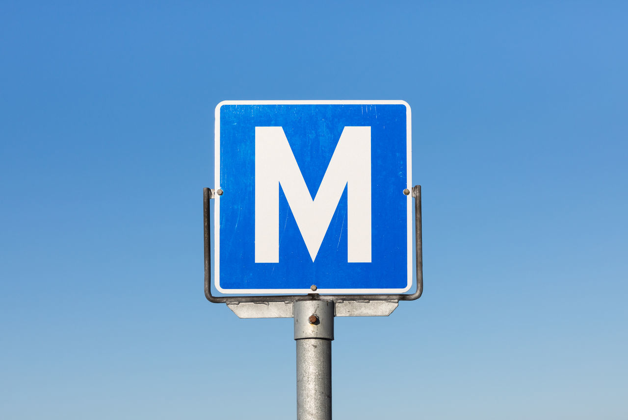 Road sign for passing place on a narrow road (Møteplass) Alphabet Blue Capital Letter Clear Sky Communication Day In The Center Information Sign Letter M Lofoten And Vesteral Islands Narrow No People Outdoors Pole Road Road Sign Simplicity Single Object Sky Square Shape Still Life Western Script