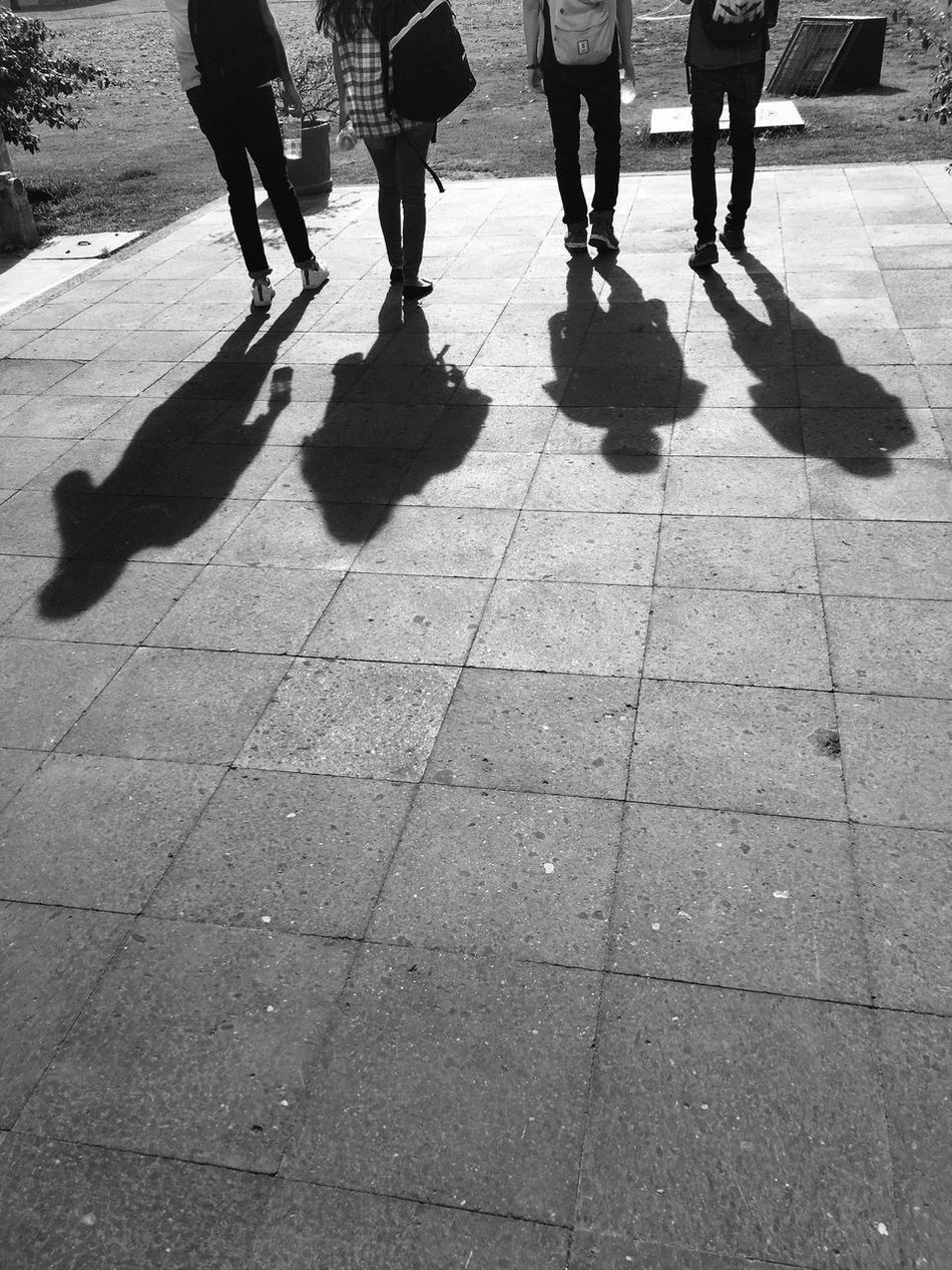 Low Section Shadow Real People Human Leg Sunlight Lifestyles Walking Human Body Part Men Day Leisure Activity Outdoors City Life Women Togetherness Standing Group Of People Adult People Only Men
