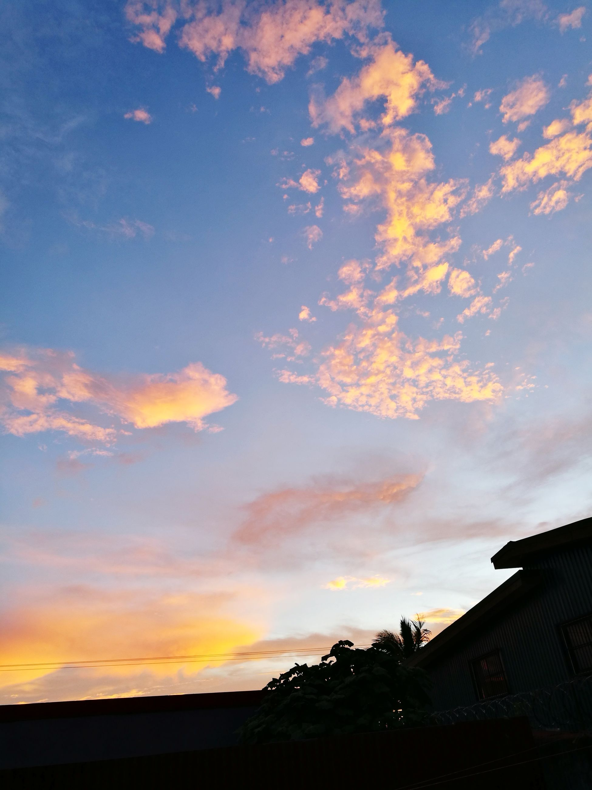 sky, built structure, architecture, house, building exterior, sunset, cloud - sky, silhouette, no people, low angle view, outdoors, nature, beauty in nature, scenics, tree, day