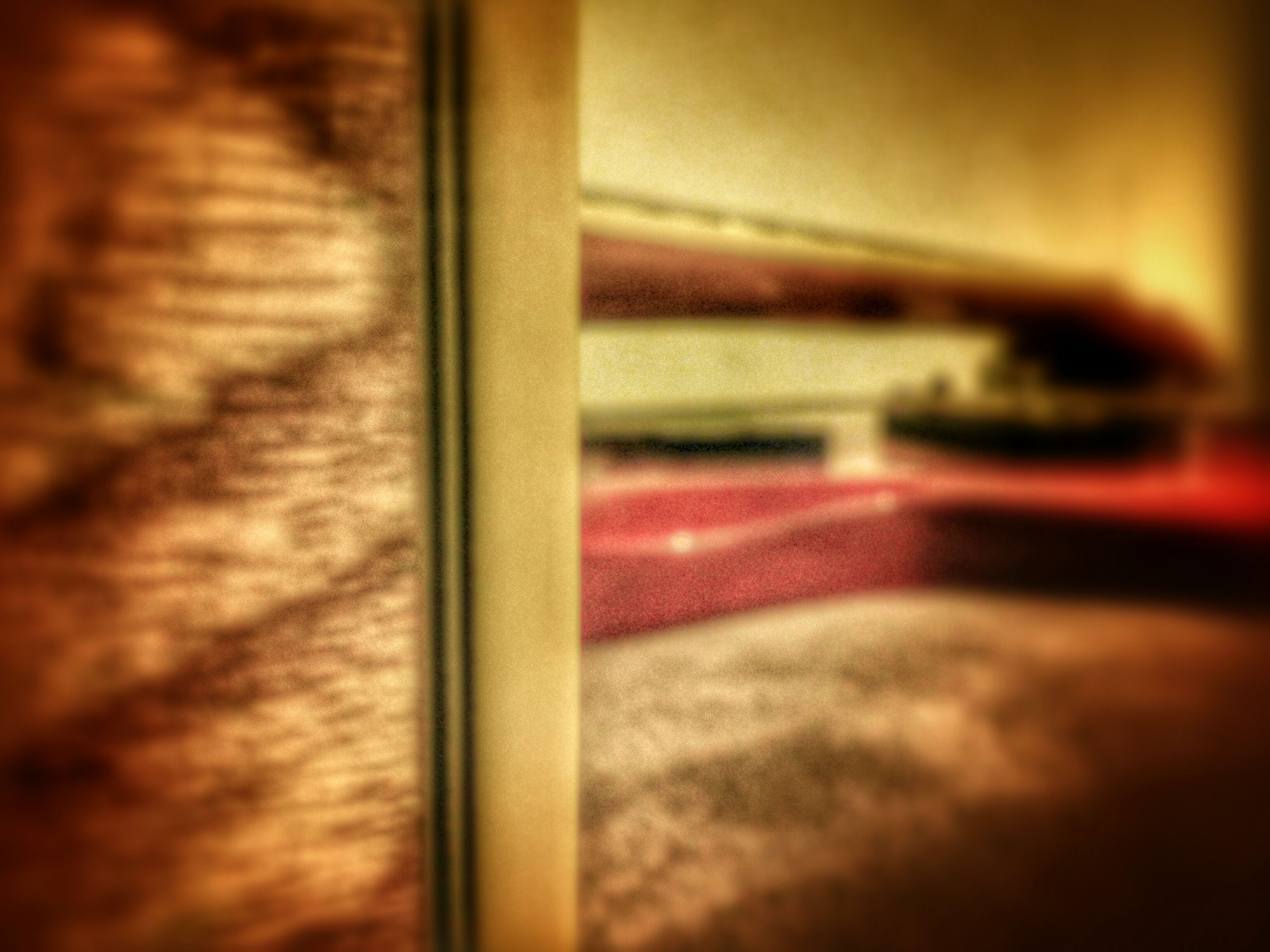 indoors, selective focus, close-up, home interior, red, no people, window, focus on foreground, flooring, absence, surface level, reflection, part of, door, detail, still life, table, wood - material, auto post production filter, curtain