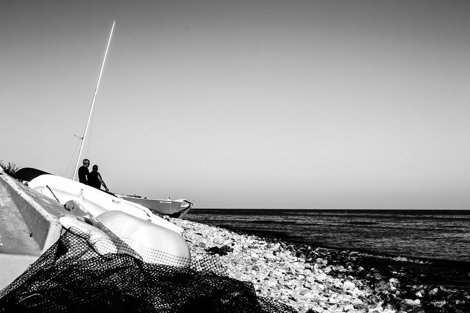 Horizon Over Water Tranquility Beach Sea People Clear Sky Fishing Fishing Boat Fishing Nets Sunlight Sailor Life Real People Tranquility Blackandwhite Photography El Campello Monochrome Photography Ships At Sea Ship At Sea FisherMens Fishermenboat SailorMars Nautical Nautical Vessel Industrial Ship Travel Destinations