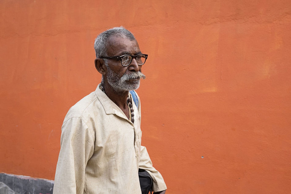 Image of a man wearing broken spectacles taken at Sonepur Mela, Bihar Beads Beard Bihar Broken Glass Broken Glasses Eyeglasses  Facial Hair Glasses Hajipur India Moustache Necklace One Man Only One Senior Man Only Orange Color Portrait Senior Adult Spectacles