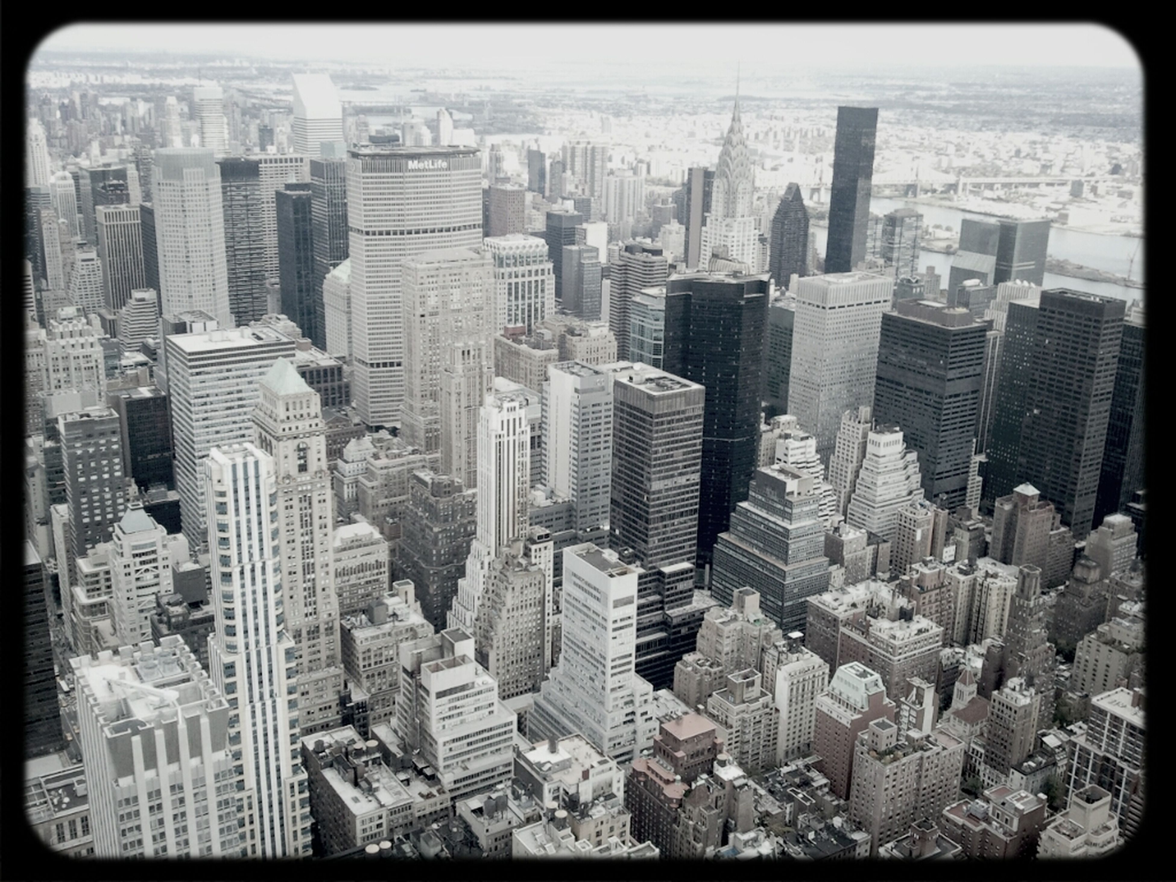 city, cityscape, skyscraper, building exterior, architecture, built structure, crowded, modern, tower, tall - high, office building, financial district, high angle view, water, aerial view, urban skyline, capital cities, transfer print, travel destinations, downtown district