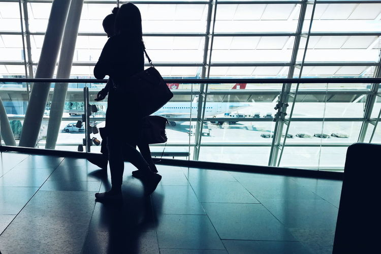 Alone Glass - Material Airports Airportphotography Travel Travel Photography Airport Hurry People Swissair Business Trip Leisure Activity Lifestyles Light Men Occupation Railing Real People Silhouettes Staircase Standing Steps Steps And Staircases The Color Of Business Women