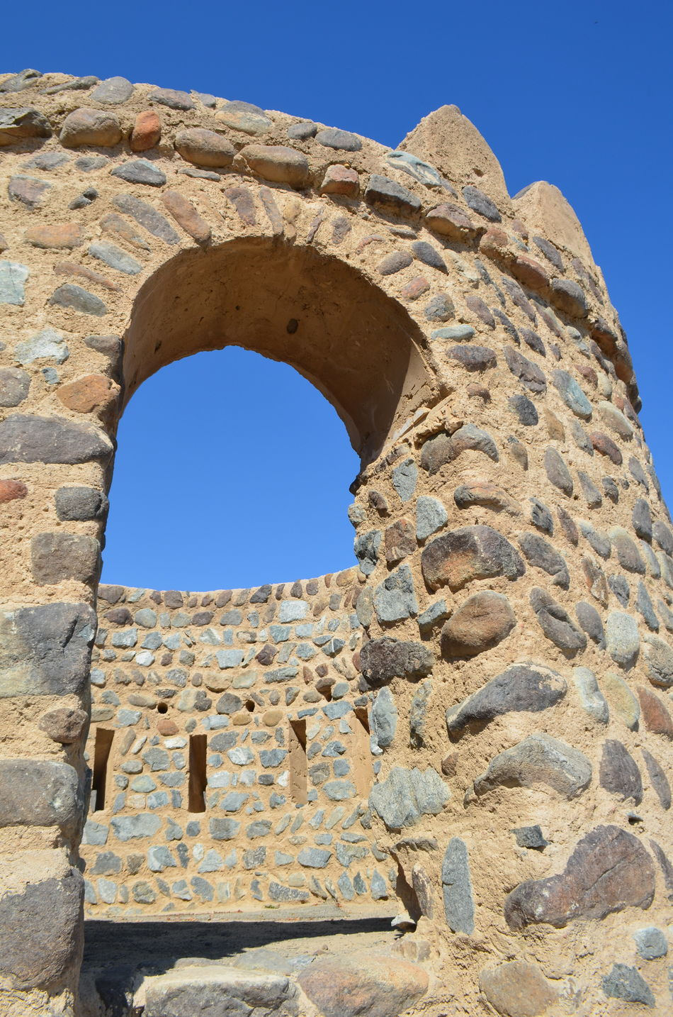 Ancient Ancient Civilization Ancient History Architecture Arid Climate Blue Sky Clear Sky Day Fort Fujairah History Low Angle View Man Made Object No People Old Ruin Outdoors Sky Stone Stone - Object Travel Destinations UAE United Arab Emirates