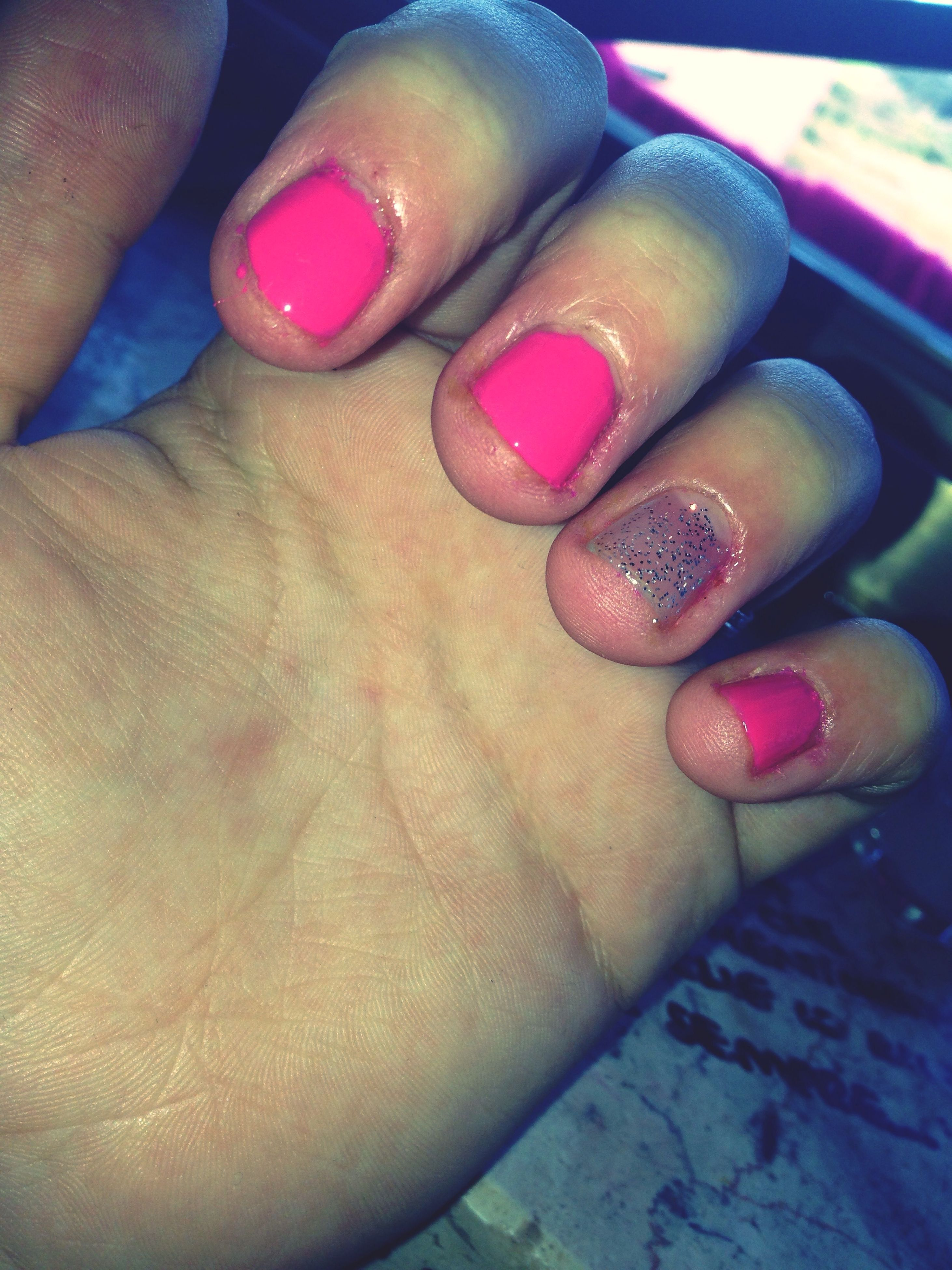 person, part of, cropped, indoors, holding, unrecognizable person, close-up, human finger, high angle view, lifestyles, multi colored, leisure activity, variation, personal perspective, nail polish