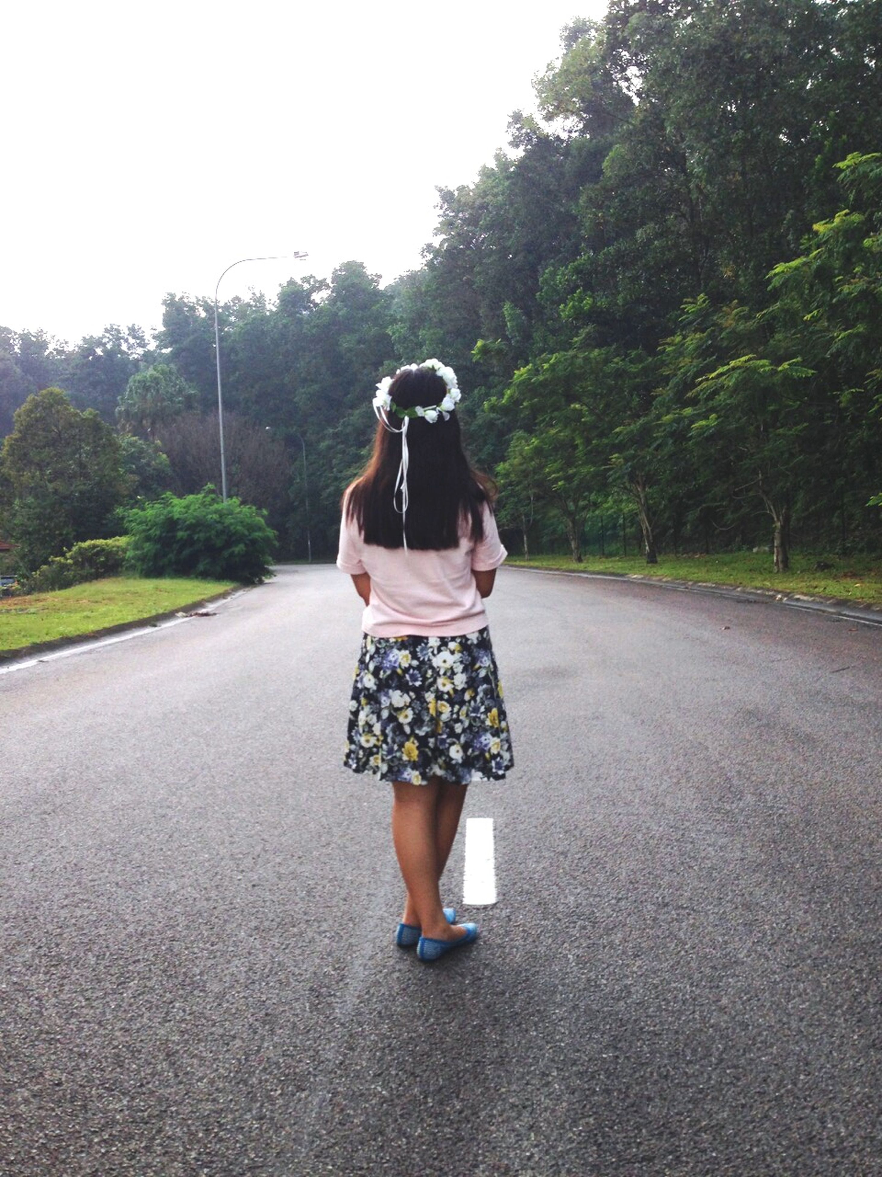 full length, lifestyles, road, casual clothing, tree, young adult, leisure activity, the way forward, young women, street, rear view, person, front view, transportation, day, standing, outdoors, walking