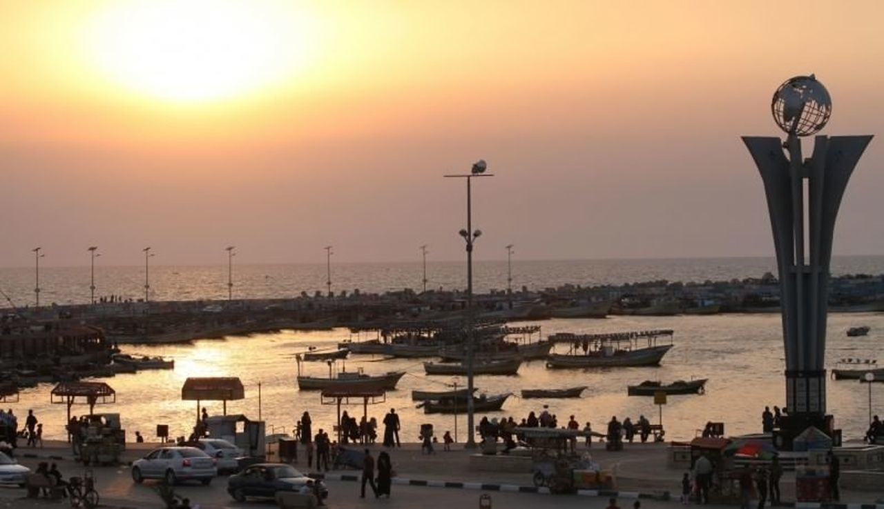 Sunset Sea Sunlight Harbor Outdoors Horizon Over Water Beach People Sky Day Gazaport Palestine