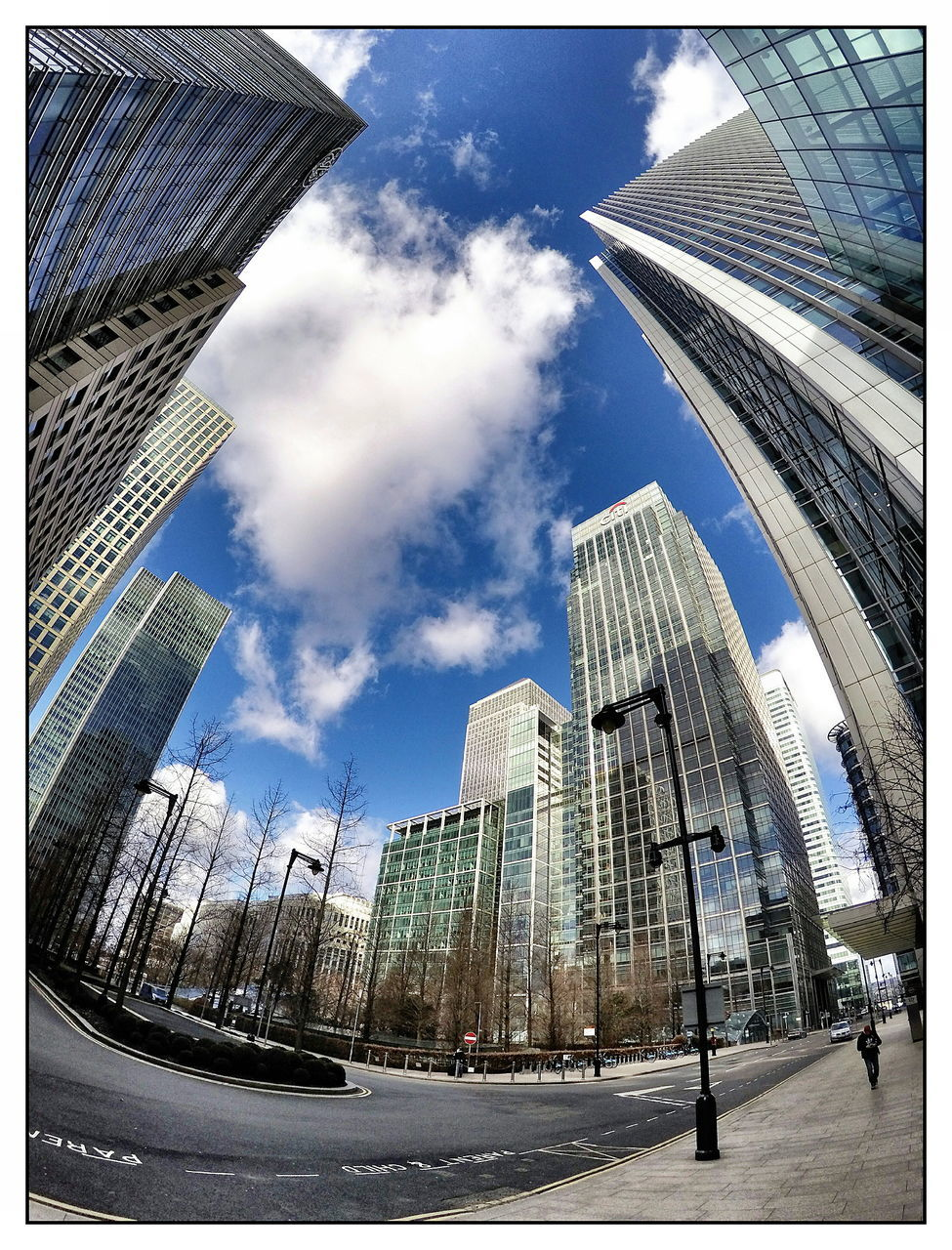 architecture, building exterior, city, skyscraper, built structure, modern, sky, city life, low angle view, office building exterior, outdoors, day, downtown district, financial district, road, travel destinations, fish-eye lens, cityscape, corporate business, no people, office park, urban skyline