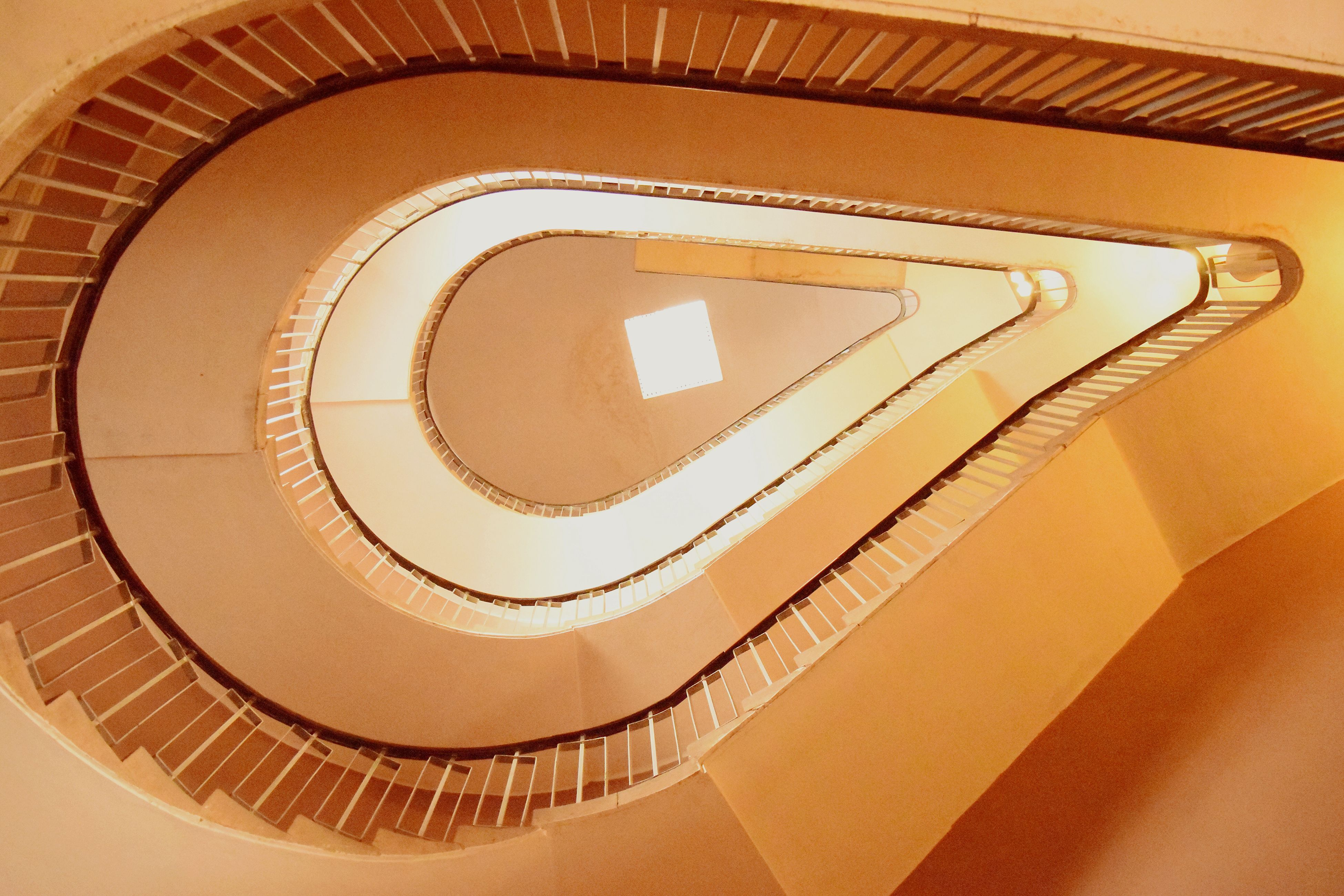 steps and staircases, staircase, steps, indoors, spiral, spiral staircase, railing, architecture, built structure, pattern, design, high angle view, stairs, circle, no people, low angle view, repetition, close-up, geometric shape, wall - building feature