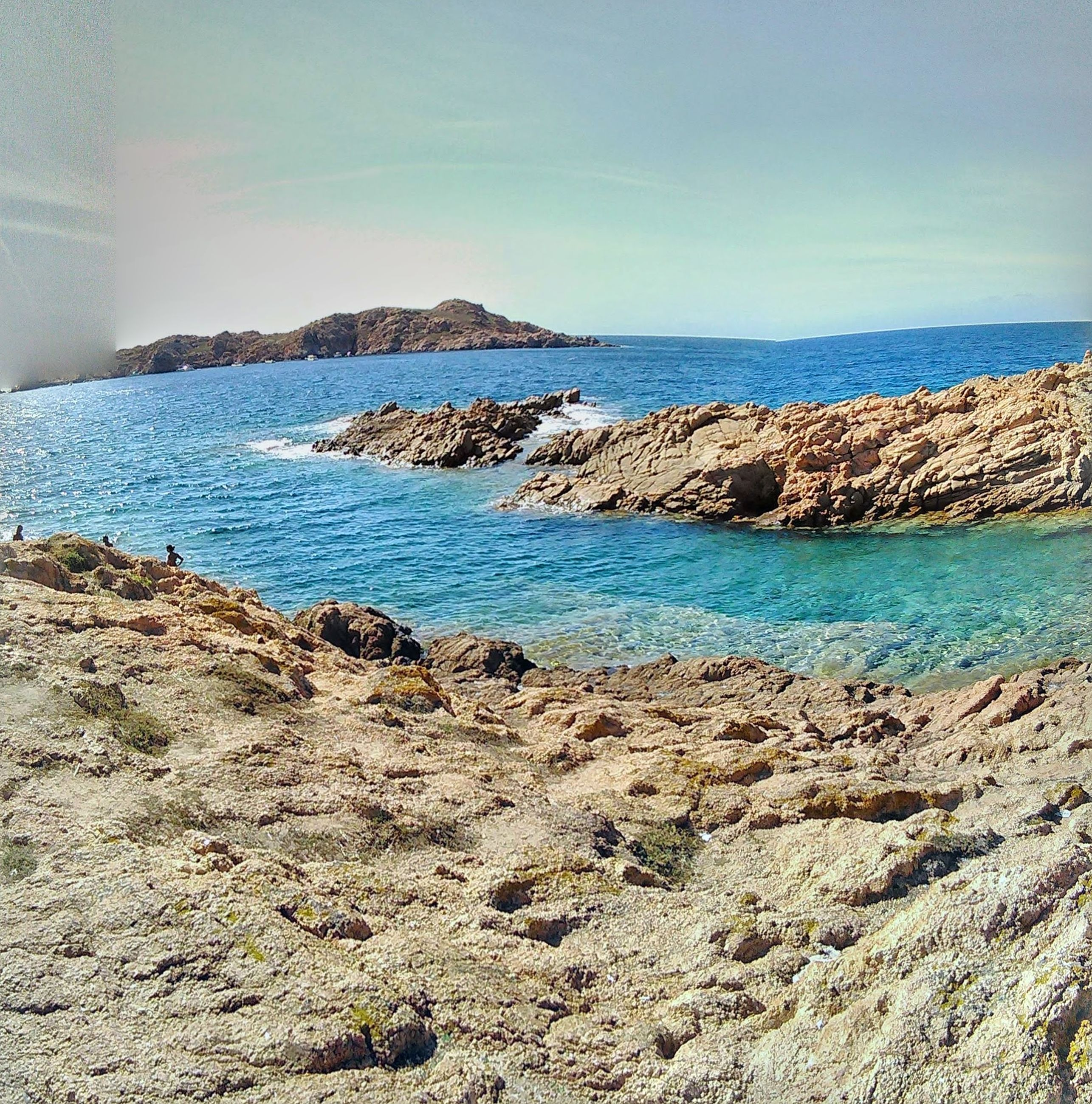 sea, water, horizon over water, beach, tranquil scene, tranquility, scenics, blue, shore, sky, beauty in nature, nature, sand, coastline, idyllic, rock - object, day, calm, outdoors, remote