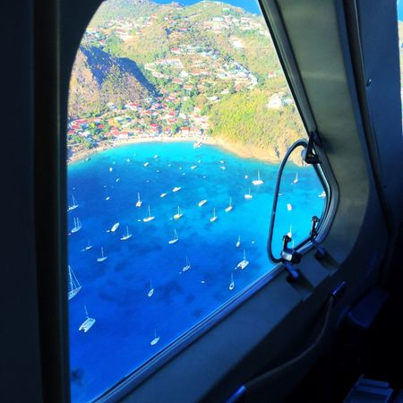 The final approach onto the beautiful island of St Barths..... Window Water Indoors  Vehicle Interior Day Close-up No People Airplane Nature View Travel St Barths