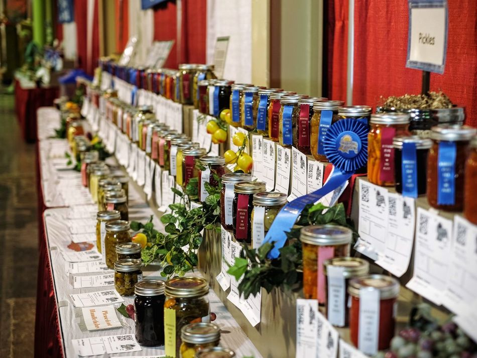 Nebraska State Fair August 2016 Grand Island, Nebraska Arrangement Camera Work Canning Canning Jars Color Photography Cultures Destination Eyeemphoto Fairground FUJIFILM X-T1 Fujinon 35mm 1.4 Getty Images Group Of Objects In A Row Large Group Of Objects MidWest Nebraska Peoples Of The World Photo Essay Preserves Small Town Stories Small Town USA State Fair Summertime Variation