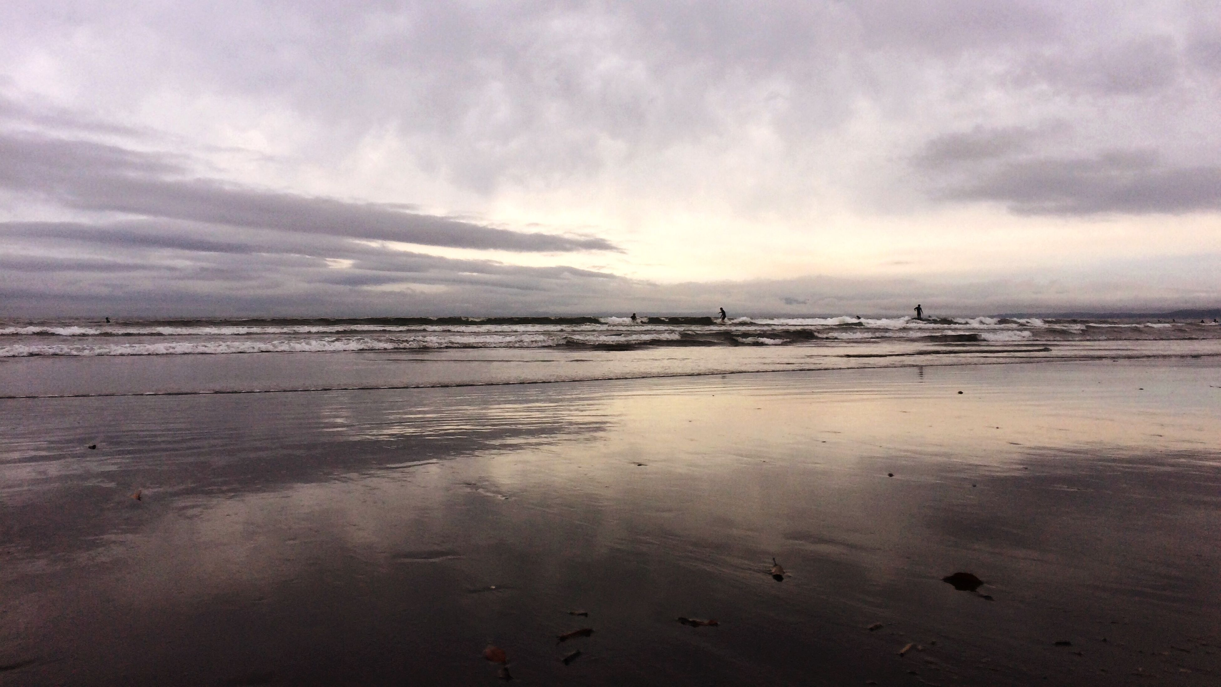 water, sky, sea, beach, cloud - sky, shore, tranquil scene, cloudy, sand, tranquility, scenics, beauty in nature, horizon over water, weather, nature, cloud, overcast, idyllic, dusk, coastline