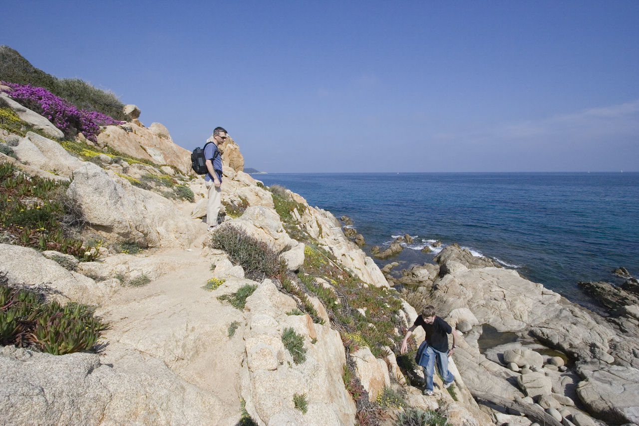 father and son - climbing on the cliffs Adventure Beauty In Nature Boy Clear Sky Cliff Climbing Côte D'Azur Exploring Family Father & Son Fatherhood Moments France Hiking Man Mediterranean Sea Nature People Real People Rock - Object Rocky Coastline Scenics Sea Sentier Du Littoral Tranquility Vacations