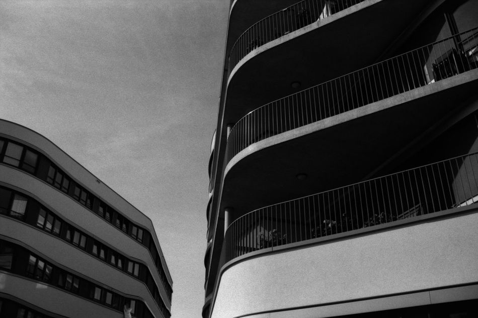 Modern Apartments 35mm Film Analogue Photography Apartment Arhitecture Balcony Black & White Building Clouds Contrast Floors Fomapan100 Glass Modern Modern Architecture Rodinal Sky Urban Window