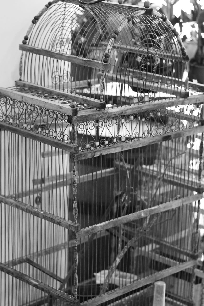 High Angle View Of Empty Birdcage