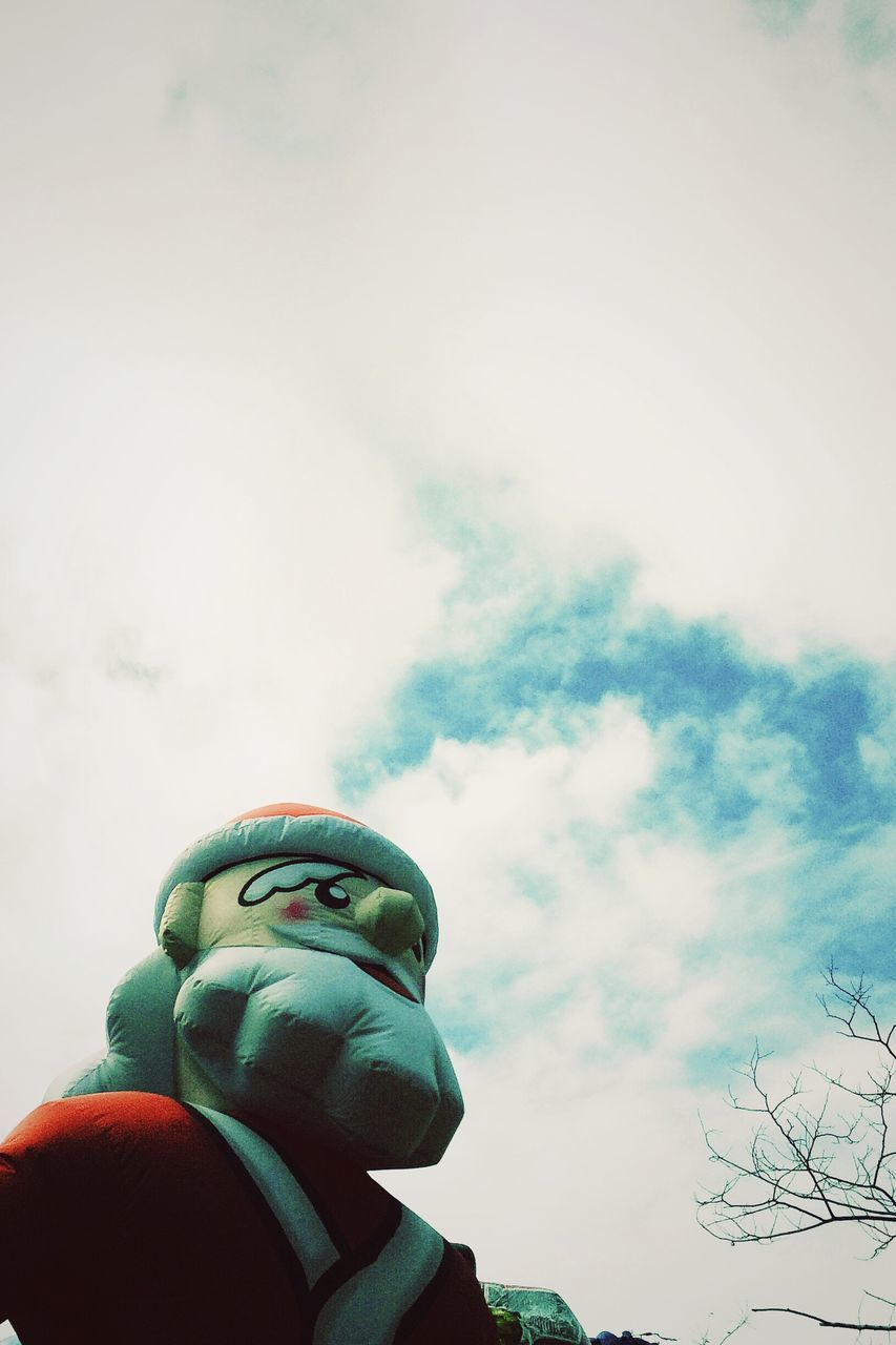 Low Angle View Of Toy Against Cloudy Sky