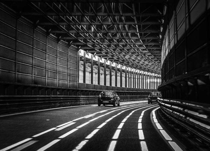 Transportation Built Structure Architecture Real People Indoors  Road Two People Day Men Illuminated City People Italy❤️ Black And White Black And White Photography The Week Of Eyeem The Week On Eyem The Week on EyeEm Editors Picks Welcome To Black Welcome To Black And White Your Ticket To Europe