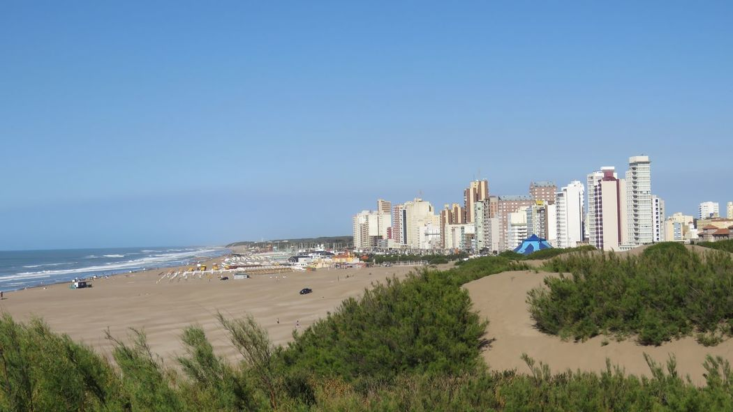 Architecture Beach Building Exterior Built Structure City Cityscape Clear Sky Day Horizon Over Water Nature Necochea. Argentina No People Outdoors Sand Sea Sky Skyscraper Travel Destinations Tree Urban Skyline Vacations Water