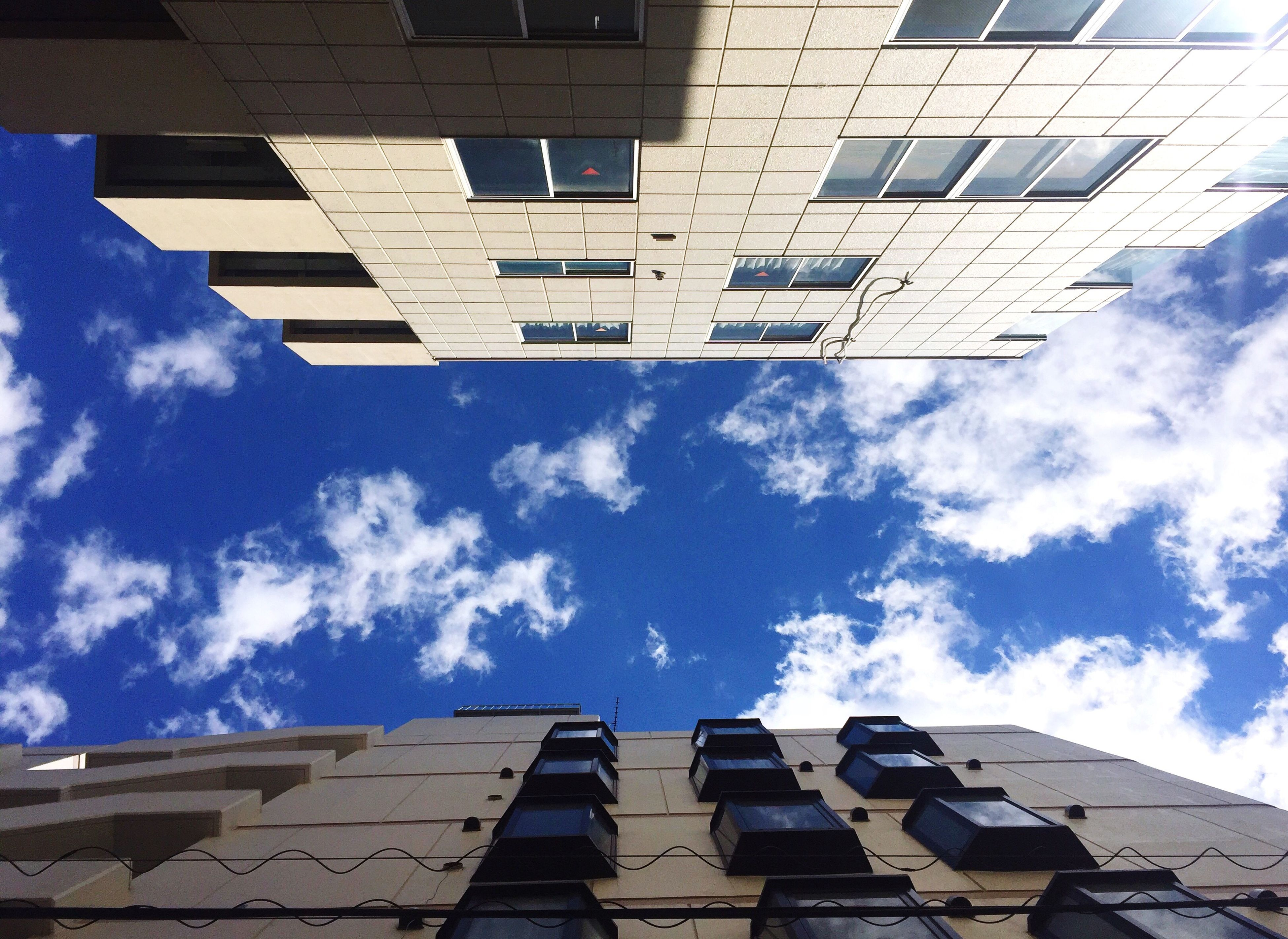 architecture, low angle view, building exterior, sky, cloud - sky, built structure, no people, day, outdoors