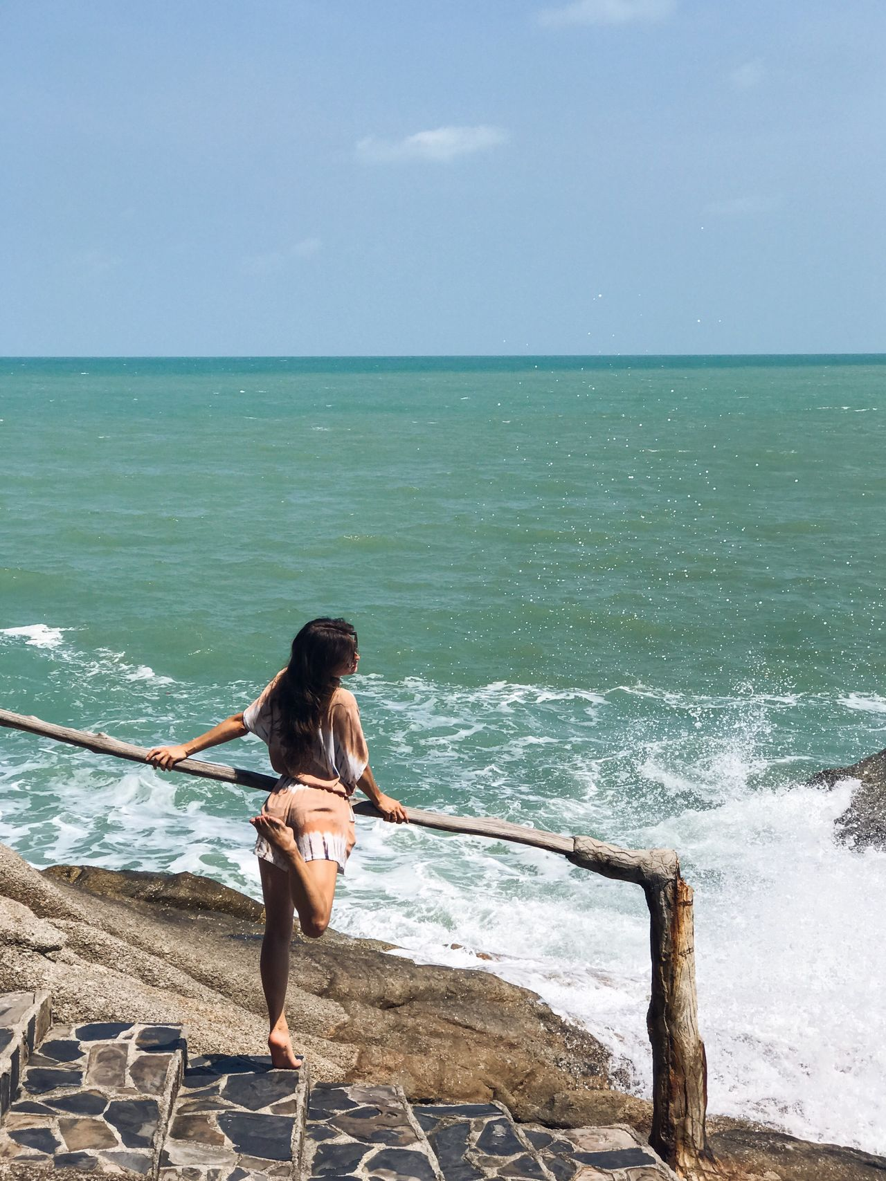 Sea Water Horizon Over Water Sky One Person Stone Steps Rocky Shore Scenics Beauty In Nature Real People Outdoors Standing Full Length Lifestyles Young Adult People One Woman Only Beach Railing Rear View Casual Clothing Leisure Activity PlayfullMood Splashing Wave