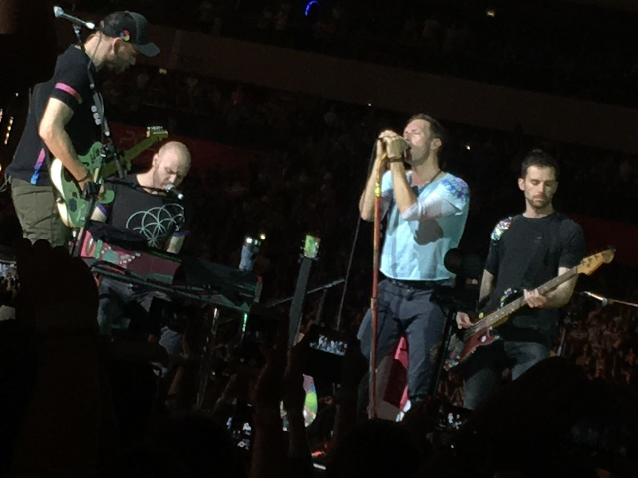 Coldplay Concert  Music Arts Culture And Entertainment Performance Night Rock Music Musician Singer  Rock Musician Guitar Group Of People Electric Guitar Musical Instrument Singing Performance Group Microphone Rock Group Illuminated Outdoors People Adult