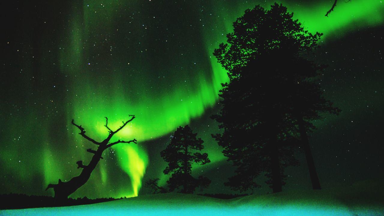 Aurora Against Star Field At Night