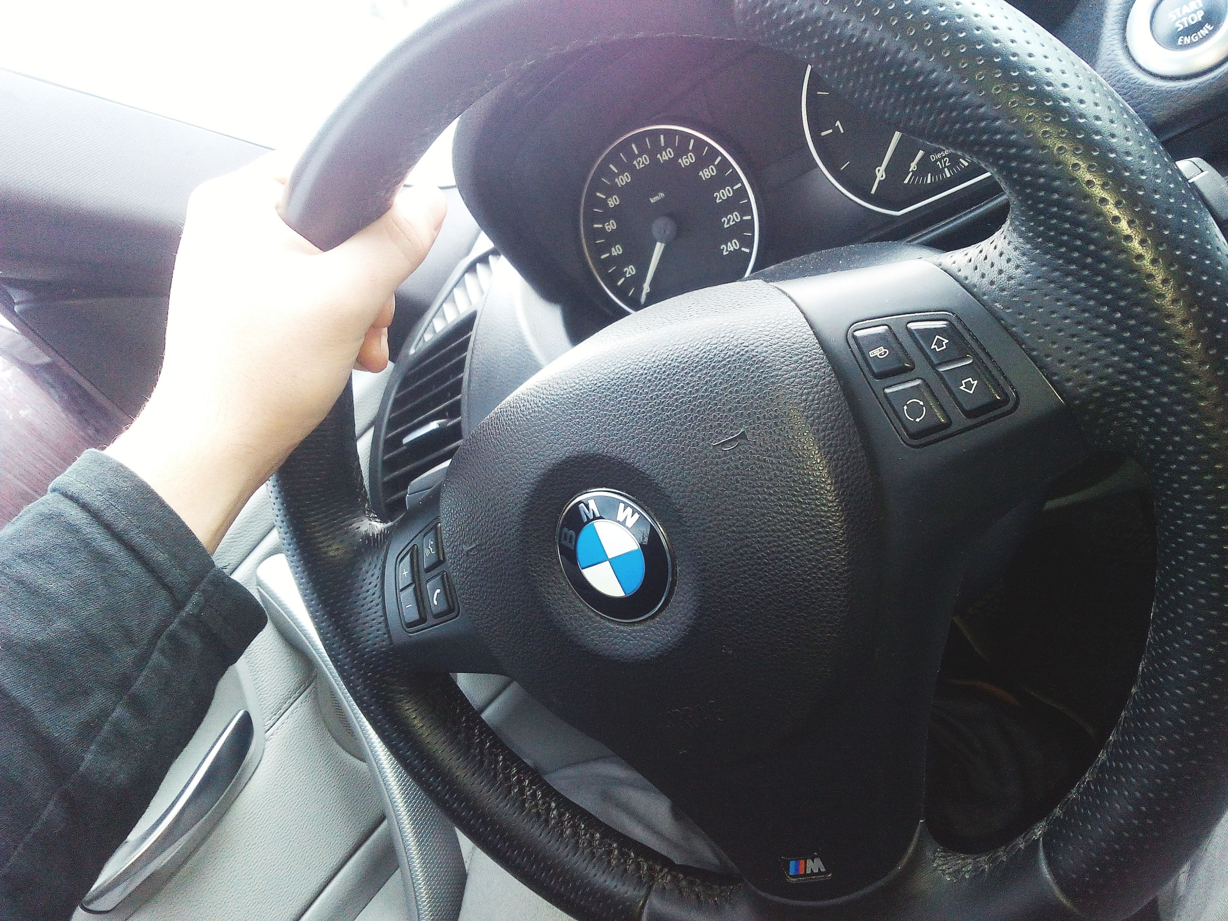 land vehicle, transportation, mode of transport, car, part of, close-up, cropped, technology, car interior, person, men, travel, vehicle interior, indoors, holding, photography themes, camera - photographic equipment