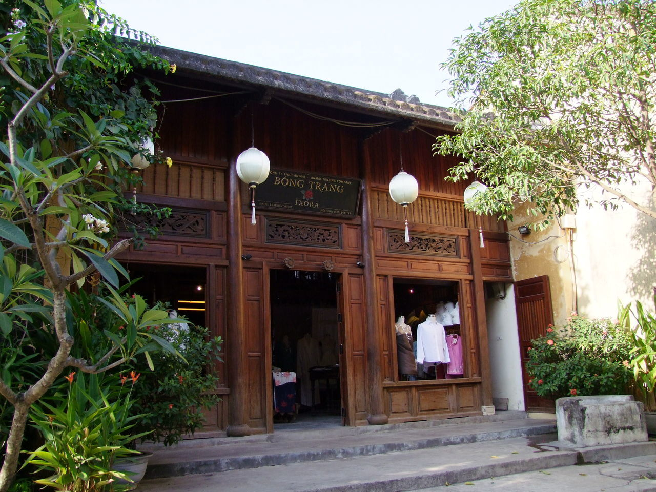 Typical Shop in Hoi An Building Building Exterior Built Structure Clothes Composition Culture Day Door Entrance Exterior Façade Full Frame Hoi An Lanterns Low Angle View No People Outdoor Photography Outdoors Retail  Shop Tourist Attraction  Traditional Trees Vietnam White Clouds