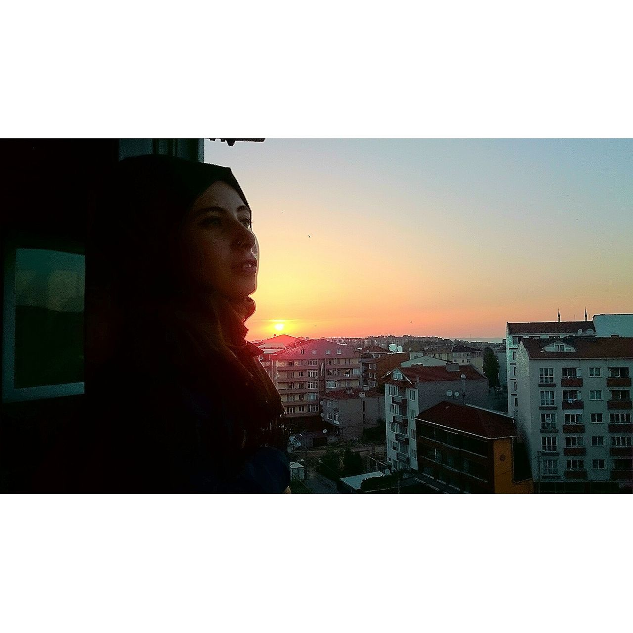 sunset, building exterior, architecture, built structure, city, one person, outdoors, clear sky, cityscape, real people, sky, young women, one young woman only, young adult, day, people