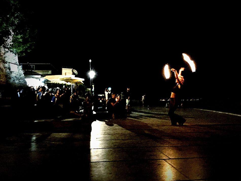 Eyeemphoto Night Men Walking Large Group Of People Person Lifestyles Illuminated Dark Light Shadow Light And Shadow Fire Street Art Lisbon Portugal VSCO Vscocam Igers Black Beauty Urban Mobilephotography