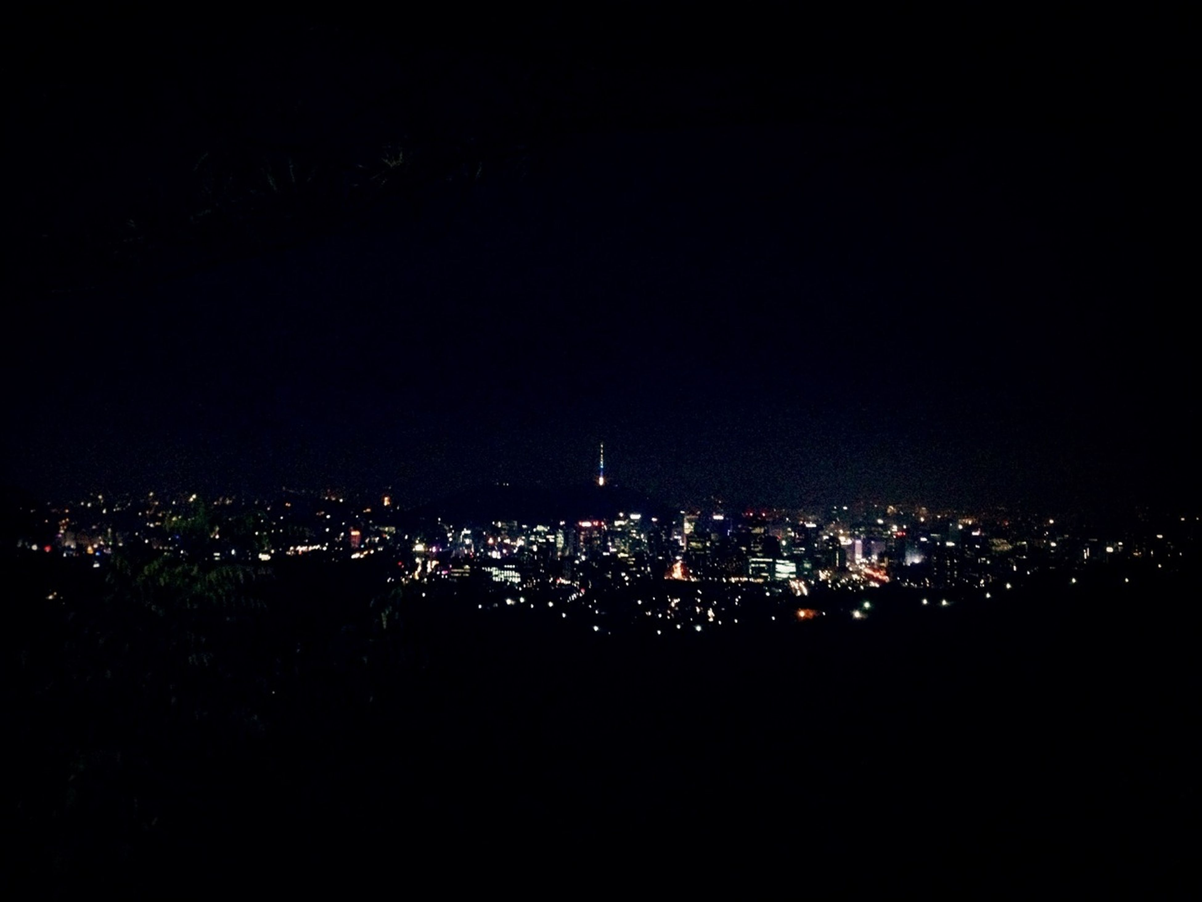 night, cityscape, illuminated, city, building exterior, architecture, crowded, built structure, copy space, high angle view, dark, aerial view, clear sky, residential district, residential building, residential structure, sky, no people, city life, outdoors