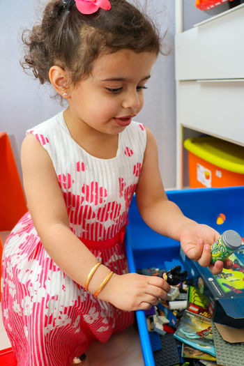 Brunette Child Childhood Cute Dress Flowers Girl Indoors  Kid LEGO Littlegirl Pink Pink Dress Playroom Searching Toy Box Toys