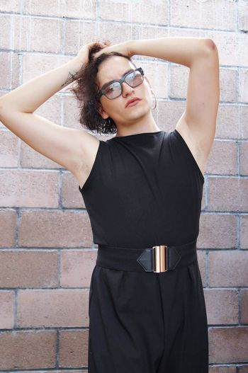 EyeEm Selects Eyeglasses  Young Adult Brick Wall Young Women One Person Standing Beautiful Woman Lifestyles Real People Portrait Day Outdoors Adult People Queer Queerlove Genderqueer Pride Model First Eyeem Photo Breathing Space