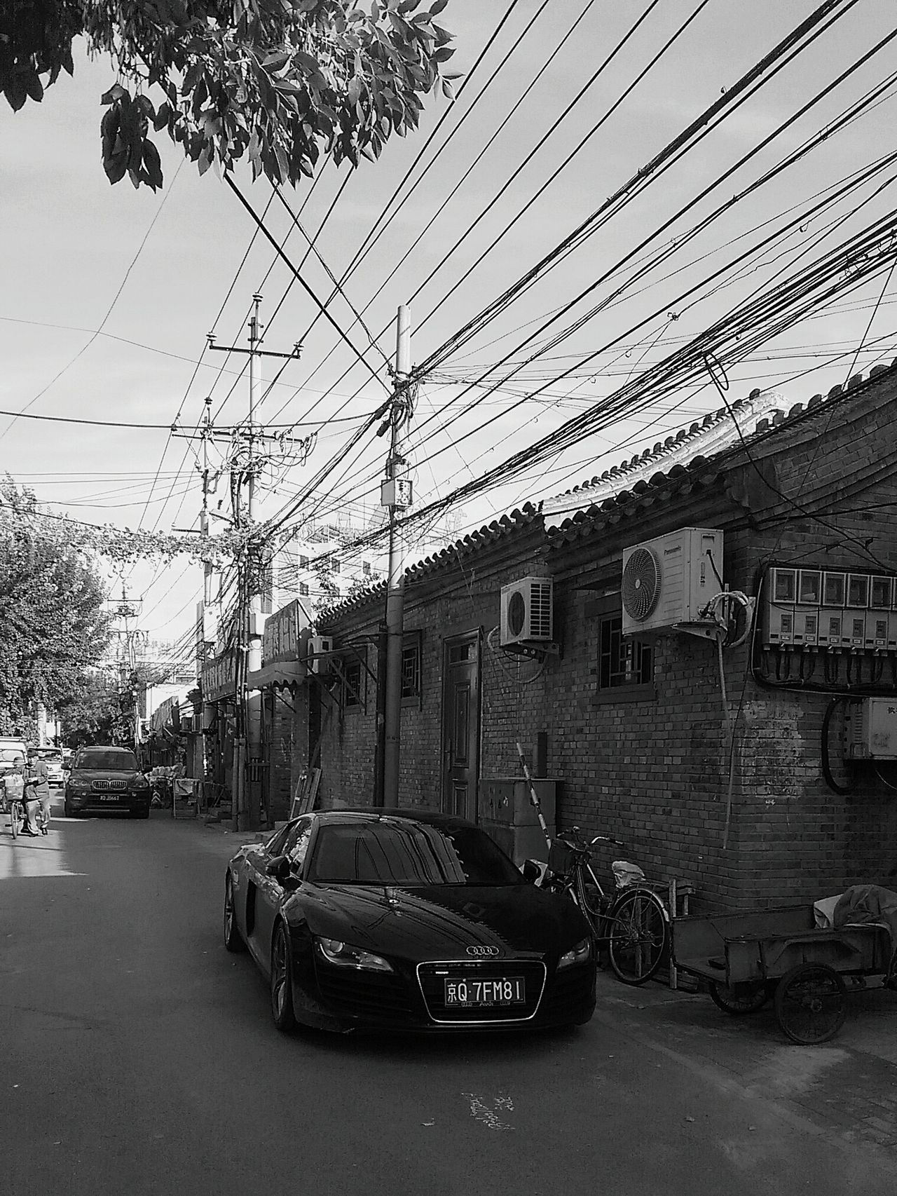 The allocation of Money is fascinating. Rich VS Poor Hutong Life NOWDAYS. Work Hard Play Hard Audi Streetphotography Streetphoto_bw Beijing, China