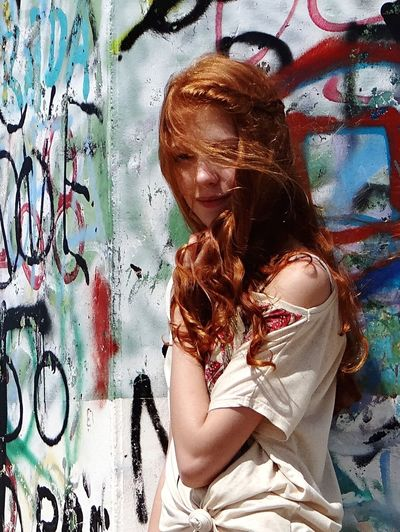 Graffiti Redhead One Person Young Adult Real People Portrait Outdoors Young Women Lifestyles