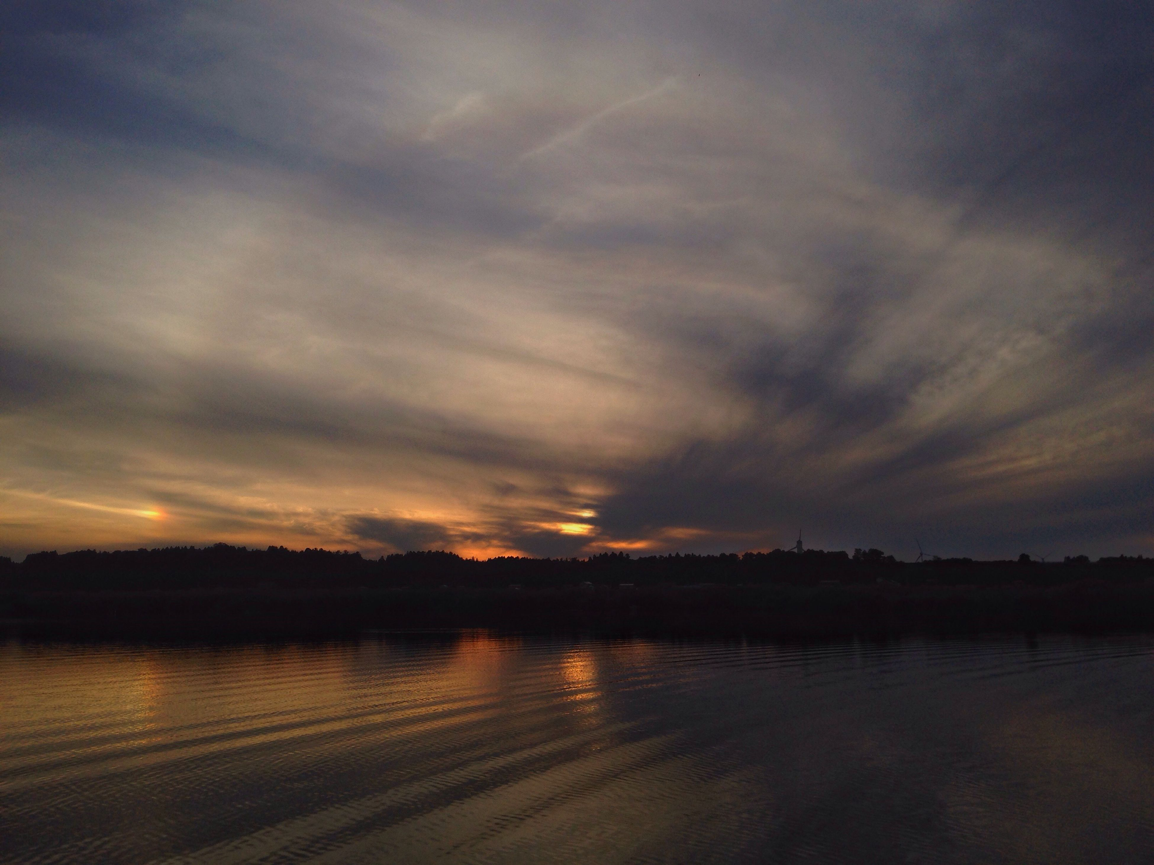 water, sunset, tranquil scene, silhouette, scenics, tranquility, lake, dusk, calm, sky, cloud, reflection, beauty in nature, cloud - sky, nature, dramatic sky, moody sky, majestic, vacations, atmosphere, cloudscape, outdoors, cloudy, tourism, atmospheric mood, no people, non-urban scene, remote, sea, storm cloud