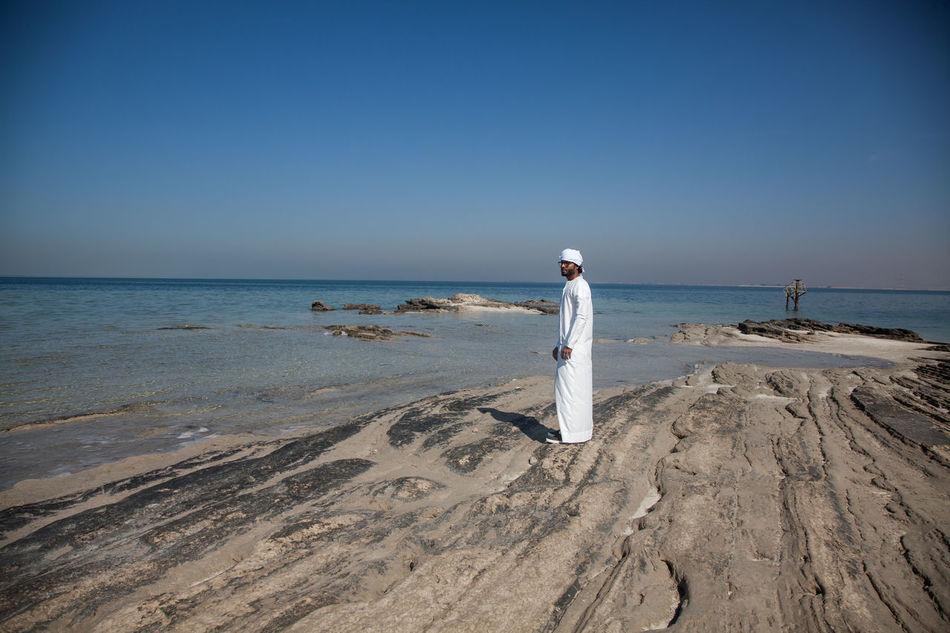 Abu Dhabi Adult Arab Arab Man Beach Clear Sky Day Emirates Emirati Emirati Arabi Horizon Over Water Human Body Part Nature Outdoors People Sea Sky