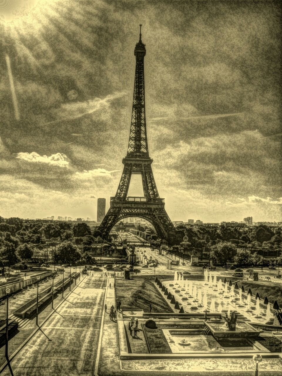 travel destinations, tourism, famous place, international landmark, eiffel tower, tower, architecture, travel, built structure, culture, capital cities, tall - high, sky, city, building exterior, history, architectural feature, metal, iron - metal, cloud, monument, cloud - sky, outdoors, city life, day, skyscraper, tall, paris, vacations, storm cloud, france, 19th century style, spire, engineering, wide shot
